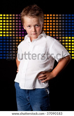 little boy wearing a white shirt posing in front of interesting background - studio photo