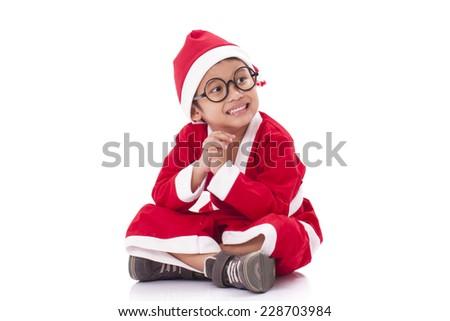 Little boy wearing Santa Claus uniform. - stock photo