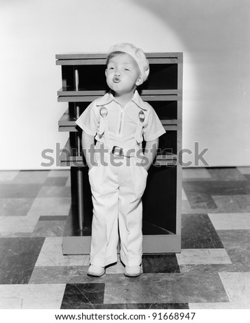 Little boy whistling - stock photo