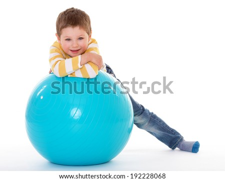 little boy with a big ball.Isolated on white background. - stock photo