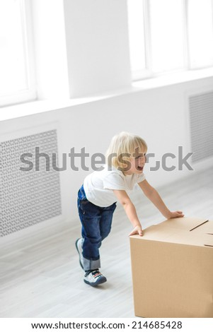 Little boy with a box