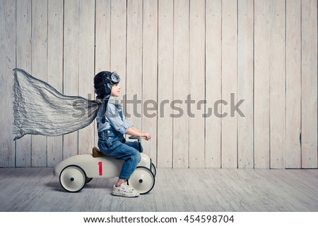 Little boy with a car in studio