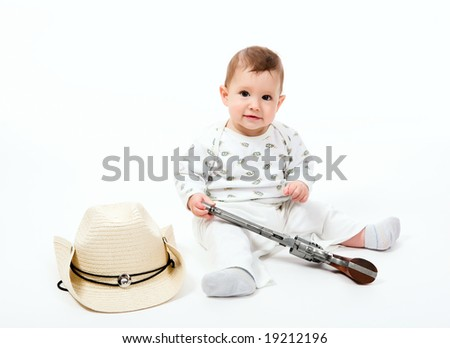 Little boy with a cowboy hat and revolver on a white background