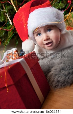 Little boy with a gift box. - stock photo
