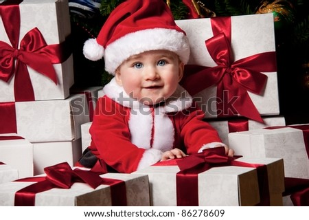 Little boy with a gift boxes. - stock photo