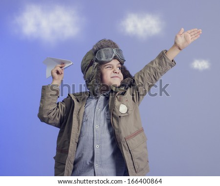 Little boy with a paper airplane. - stock photo