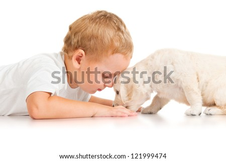 Little boy with a puppy - stock photo