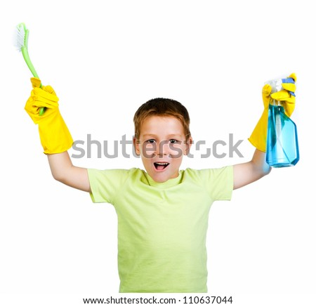 little boy with a rag and can of detergent