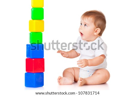 Little boy with a toy blocks, isolated on white - stock photo