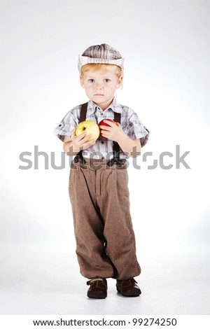 little boy with apples - stock photo
