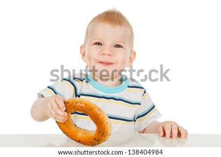 Little boy with bagel - stock photo