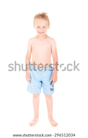 little boy with beach shorts isolated in white background - stock photo