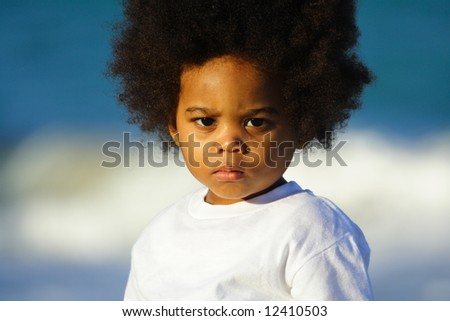 Little boy with blurry water background - stock photo