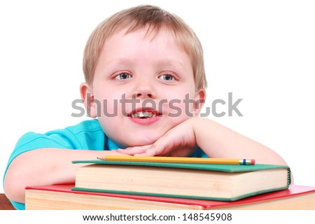 Little boy with books - stock photo
