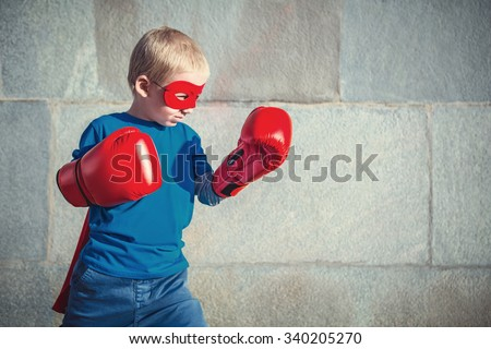 Little boy with boxing gloves - stock photo