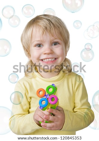 little boy with bubbles gun on white background