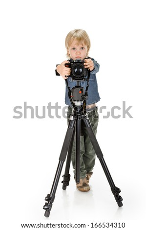 little boy with camera on tripod full length on white background - stock photo