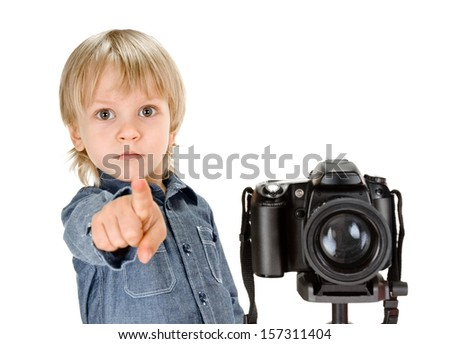 little boy with camera on tripod on white background - stock photo