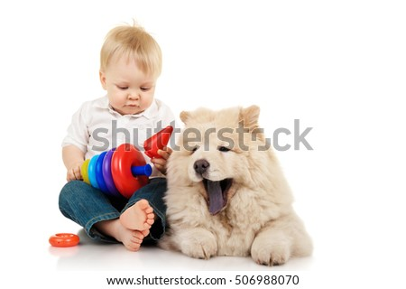 Little boy with chow-chow puppy