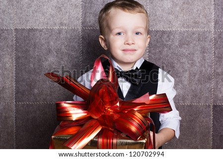 Little boy with Christmas gift - stock photo