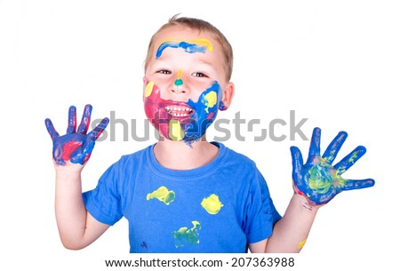 little boy with colorful paint on the face and hands