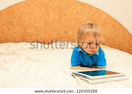 little boy with digital tablet at home