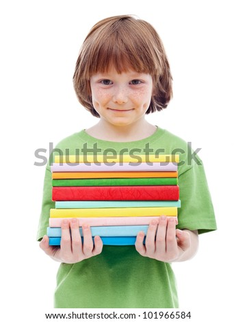 Little boy with freckles and mischievous smile holding books - isolated - stock photo