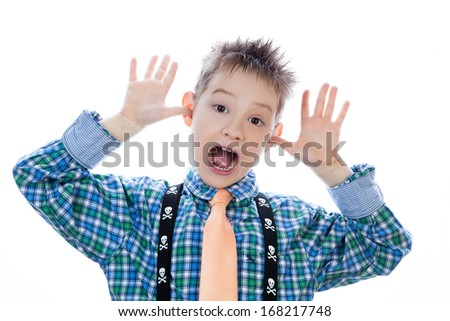 Little boy with funny face isolated on white