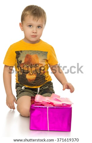 Little boy with gift - stock photo