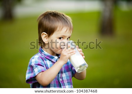 little boy with glass of milk - stock photo