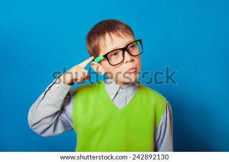 Little boy with glasses for vision - stock photo