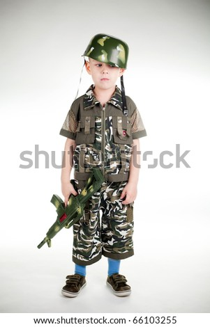 little boy with gun isolated on white background