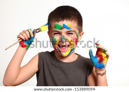 little boy with her hands in paint  - stock photo