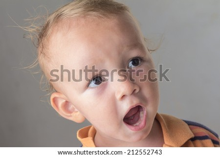 Little boy with his mouth open