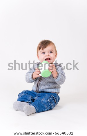 Little boy with kid's mug