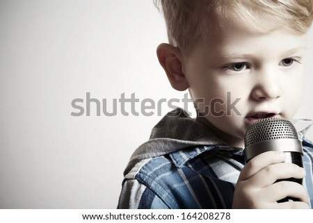 little boy with microphone. child in karaoke. stylish singer.your text here - stock photo