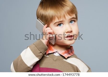 Little boy with mobile phone  - stock photo