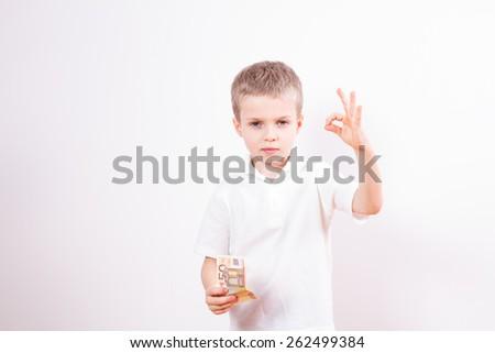 Little boy with money euro - stock photo