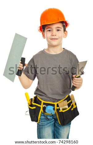 Little boy with orange helmet holding notched and spatula against white background - stock photo