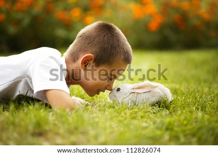 little boy with rabbit - stock photo