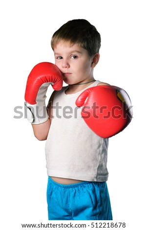 Little boy with red boxing gloves on white background isolated