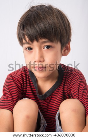 Little boy with sadness face portrait - stock photo