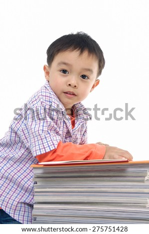 Little boy with set of books on white - stock photo