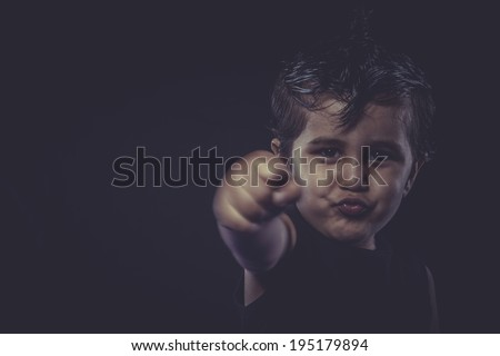 little boy with slicked-back hair, funny and expressive - stock photo