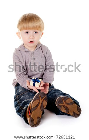 little boy with small gift in hand