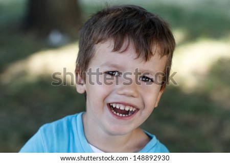 Little boy with teeth smile, outdoor
