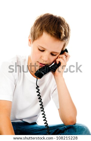 little boy with telephone isolated on a white background - stock photo