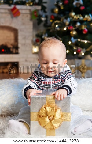 Little boy with the packaged gift - stock photo