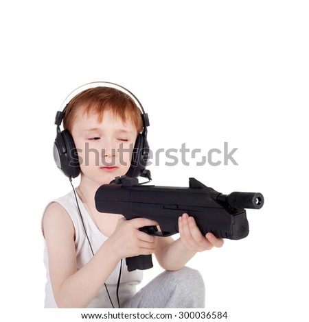 little boy with the weapon - stock photo