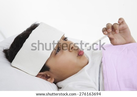 Little boy with thermometer in his mouth - stock photo